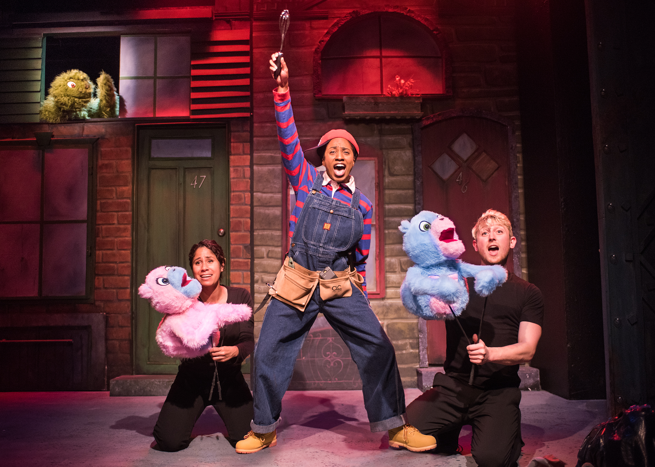 Trekkie Monster, The Bad Idea Bears (Alex Akin and Jake Gale) and Gary Coleman (Angel Adedokun) encourage the Avenue Q residents to be as loud as they want. Photo by Lois Tema.