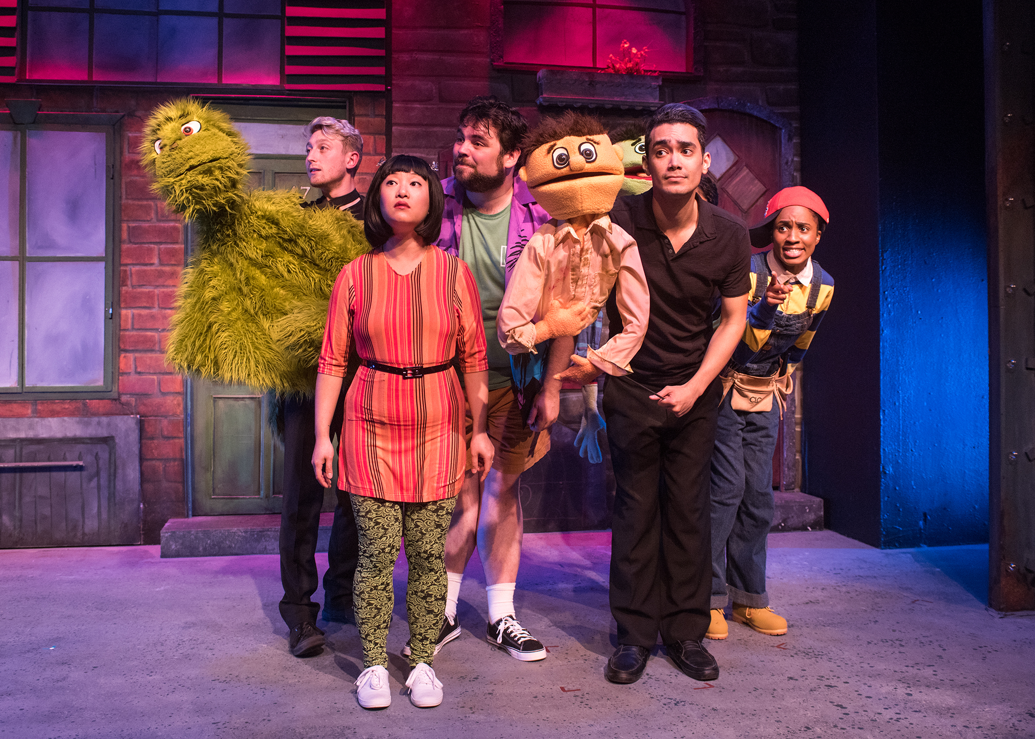The Avenue Q ensemble explores life outside their apartments. Photo by Lois Tema.