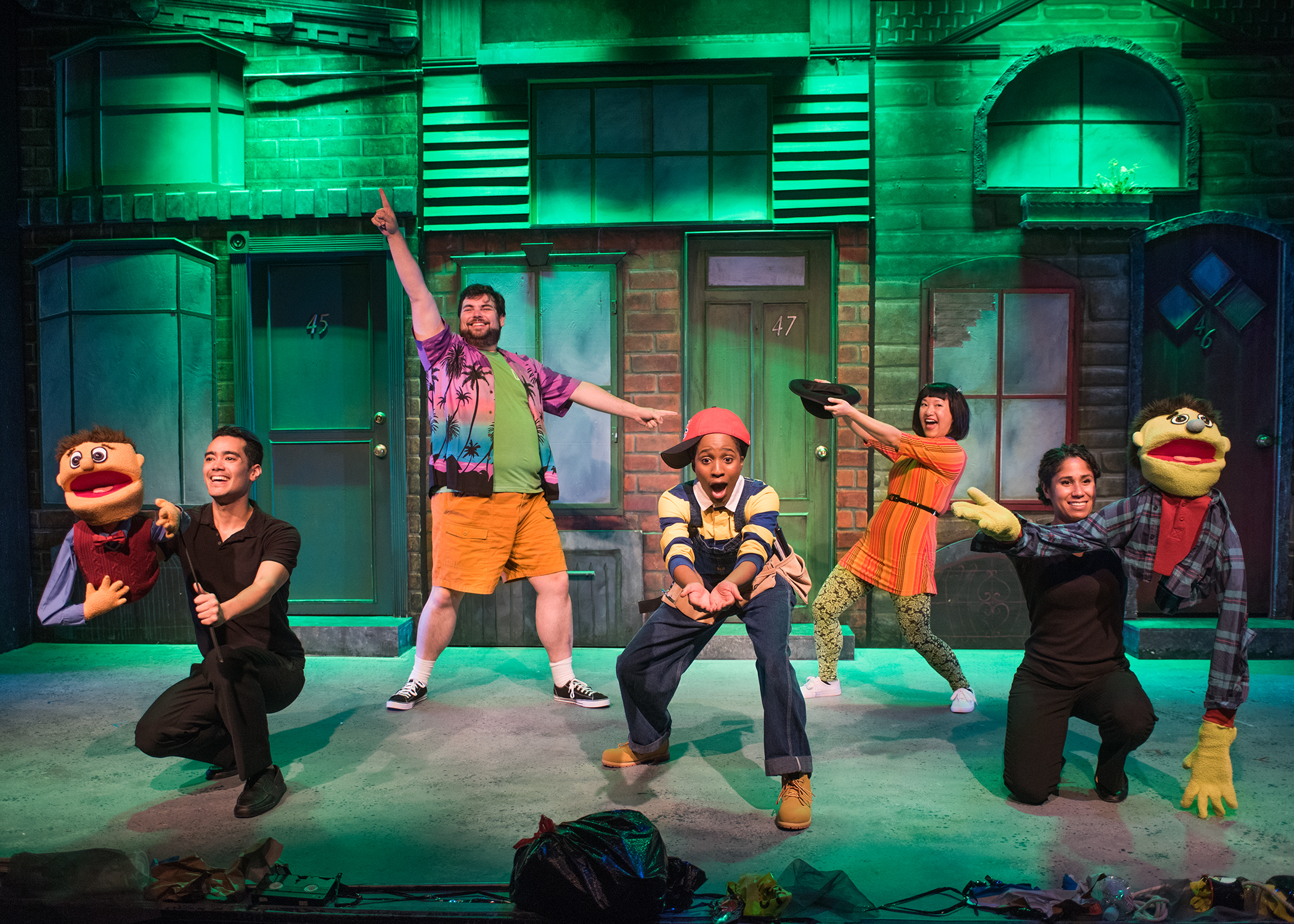 The Avenue Q ensemble (L to R: Nick Rodrigues, Ted Zoldan, Angel Adedokun, Isabel Anne To, and Alex Akin) wants your money. Photo by Lois Tema.