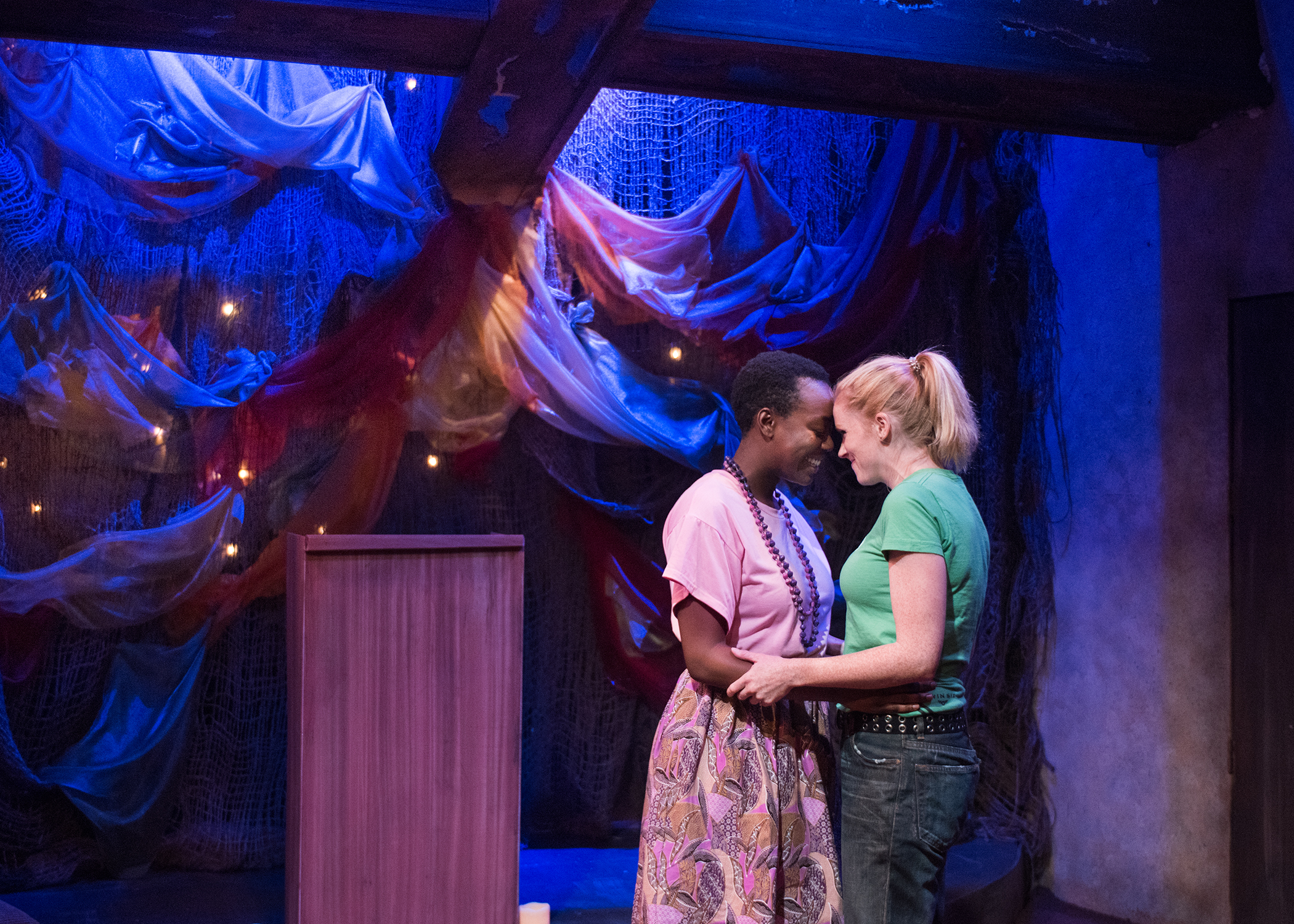 Adiel (Gabriella Momah) and Chris (Megan Timpane) share a stolen moment together. Photo by Lois Tema.