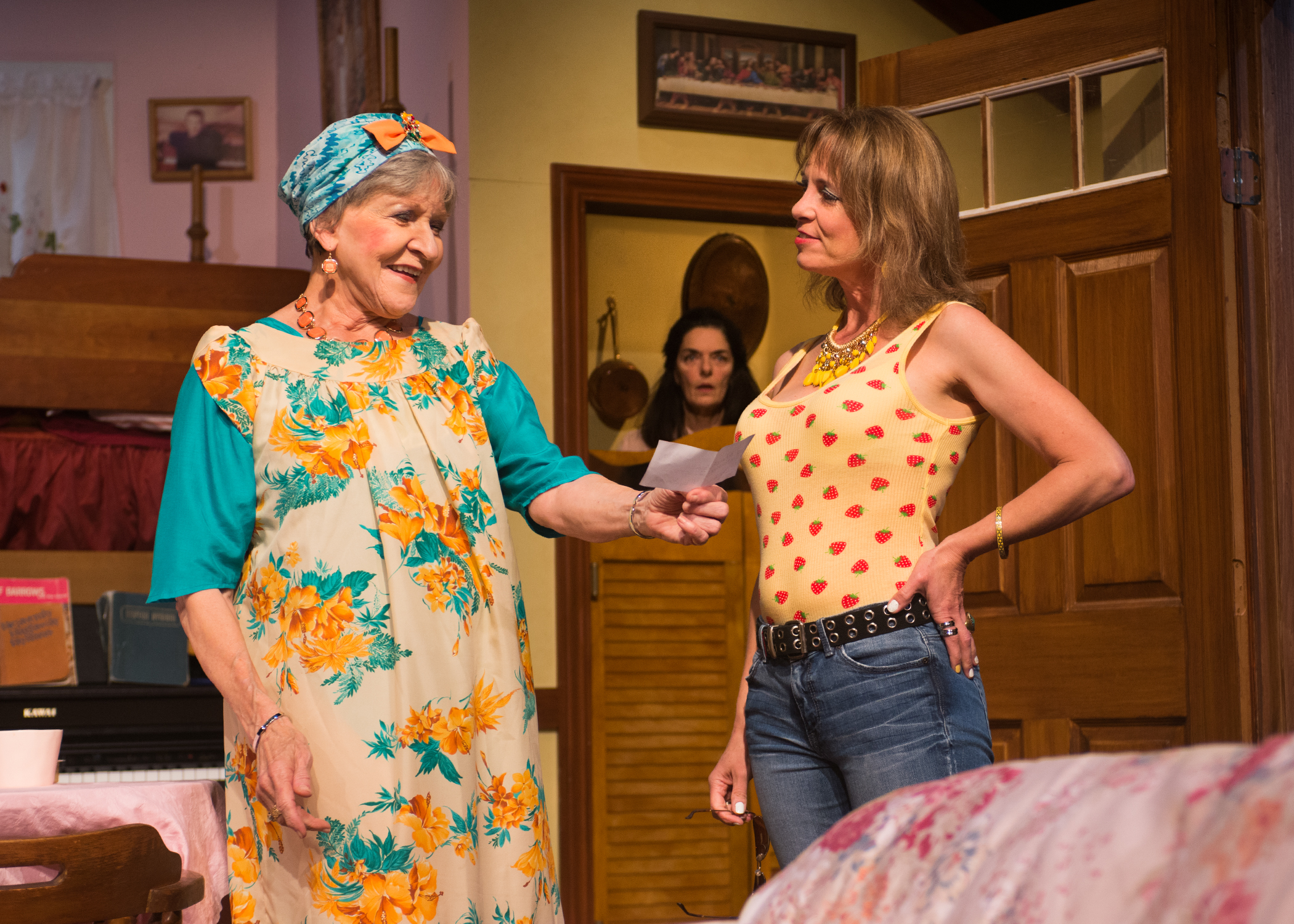 Pictured: Ditty Blaylock (Christine Macomber) celebrates the return of her prodigal daught Bethany (Amy Meyers)while her eldest daughter Rachel (Cheryl Smith) looks on. Photo by Lois Tema.