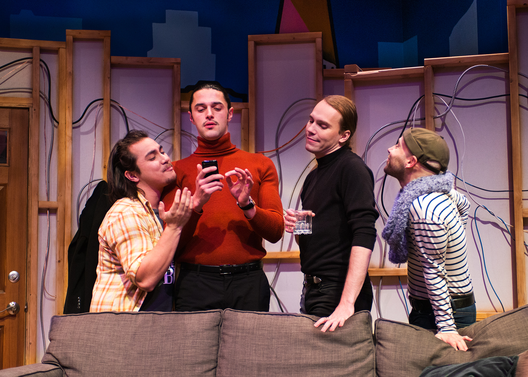 Pictured L to R: Smitty (Sal Mattos), Marcos (Vaho), J (Chris Steele) and Dev (Devon Marra) reminisce about past kikis. Photo by Lois Tema. (Low-Res)